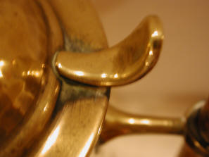 thumb catch on brass jug