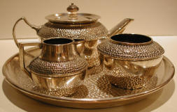 tea kettle, cream and sugar bowls, & tray